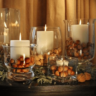 fall fireplace decor - acorn and candle vases
