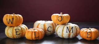 fall fireplace decor - stamped mini pumpkins