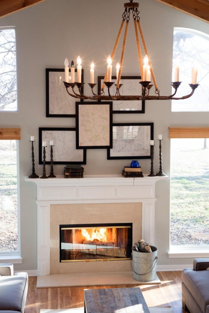 fireplace mantel with framed blueprints