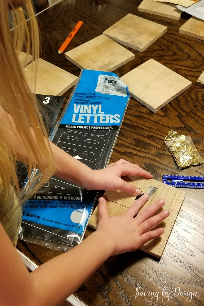 how to apply vinyl stickers to scrabble wall tiles